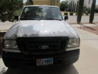 It is a white ford ranger 2004, 4 cyl, automatic,