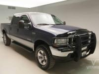 This 2004 Ford Super Duty F-250 Lariat Crew Cab 4x4 Fx4
