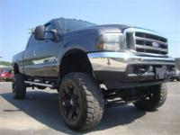 LARIAT!! LIFT KIT!! STAR WHEELS!! This 2004 Ford Super