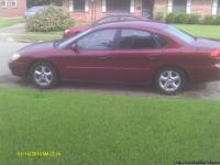 2004 Ford Taurus SE 134,000 mileage, burgandy in color,