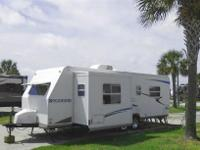 With slide out travel trailer awning fully