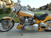 Combine a fat chrome handlebar, custom headlight and