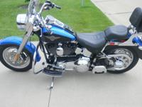 Beautiful Black over Blue HD Fatboy. Lots of chrome and