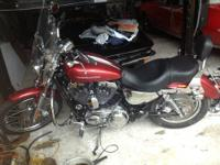 THIS IS A 2004 HARLEY DAVIDSON SPORTSTER XL 1200C WITH