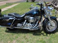 Very nice bike. Chromed and flamed out. Has Harley