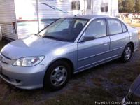 2004 honda Civic Hybrid light blue four door 100,000