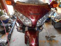 2004 Honda Goldwing 1800 burgundy with a ton of chrome