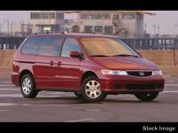 This 2004 Honda Odyssey 5DR EX-RES W/DVD is a real