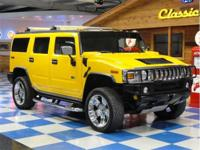 2004 Hummer H2. 39,204 miles Yellow with Gray leather