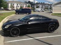 2004 Infiniti G35 coupe. Black with tan leather
