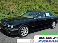 Options Included: N/AJaguar XJ in sleek BLACK! All the