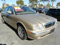 This TOPEZ XJ equipped with MOON ROOF, LOW MILES, CLEAN