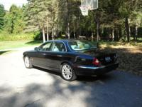 SUPERCHARGED Jaguar sedan in perfect condition. In and