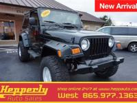 This 2004 Jeep Wrangler in Black features. Carfax