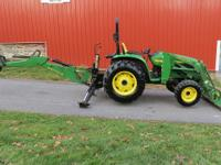 This is a 2004 John Deere 4710 4x4 Compact Tractor with