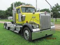 Yellow truck with black fenders. Conventional Trucks