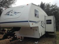2004 Keystone Cougar M-278EFS. 1 Slide out and 1 Patio