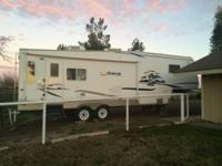 2004 Keystone Cougar M-29RLS 5th Wheel. Length 29FT-