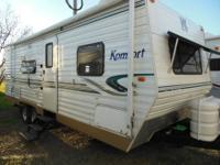 This Komfort 25 foot travel trailer features a front