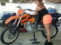 This is a 2004 KTM 450 SX four stroke dirt bike. It is