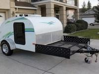 This trailer is exceptional, has a full size bed, rear