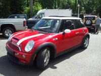 This is a 2004 Mini Cooper S 6 speed Manual. This