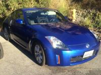 2004 nissan 350z lover coupe. 6 speed MANUAL
