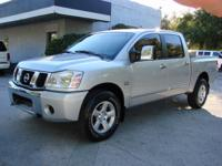 You are looking at a Nice 2004 Nissan Titan SE Crew Cab