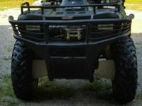 2004 Polaris Sportsman 700 V-Twin 4x4 Automatic. This 4
