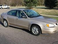 You are looking at a 2004 Pontiac Grand Am Sedan with a