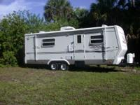 Self-contained travel trailer. Queen bed,fully equipped