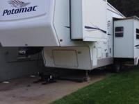 This is a 2004 Potomac 5330RLKS 5th Wheel, it has 3