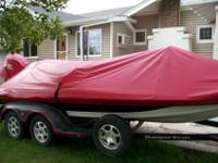Boat is a 2004 model and Motor is a 2009 Evinrude 200