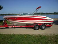 You are looking at a very nice 2004 Regal 2200. Red