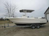 The 230 Center Console T-Top has a Yamaha 225 outboard