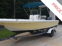 This is an extremely well kept bay boat and trailer