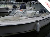 This Sea Hunt 200 Escape is powered by a 2 stroke