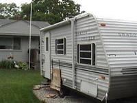 18 foot travel trailer. air, heat, hot water. LP stove,