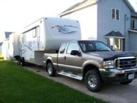 2004 New Vision Sportsmen 5th wheel camper. M-3158