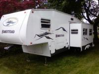 29Ft fifth wheel three bunks in back large slide out