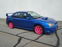 2004 Subaru Impreza WRX STi sedan. Rally Blue with