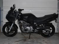 This is a 2004 Suzuki GS500F. Just 8,523 miles