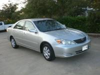 2004 Toyota Camry LE. Illuminated entry and Remote