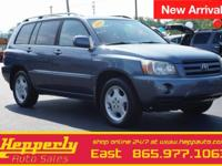 This 2004 Toyota Highlander Limited in Bluestone