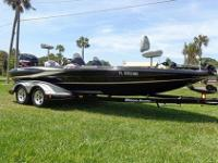 2004 TRITON TR-21X BASS MASTER CLASSIC. MOTOR IS 225
