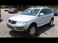 2004 Volkswagen Touareg. This SUV includes a V8 engine,