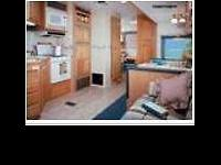 Wildcat 5th Wheel with 1 Queen Bed and 4 Bunks. By