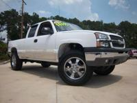 "Options Included: 20"" Chrome Wheels, Air Conditioning,"