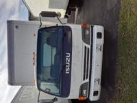 "2004 ISUZU NPR BOX TRUCK w/liftgate 18"" box Runs great,"