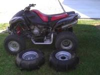 This is a 2004 Kawasaki KFX 700 that is in very good